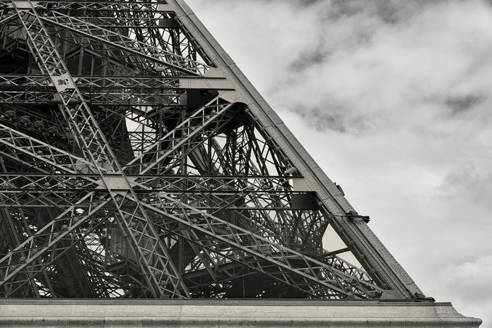 Detailed view of a section of the Eiffel Tower in Paris.
