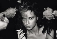Adriana Lima smoking sexy black and white image.