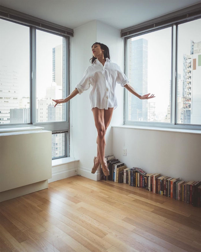 Alexandra Jacob seems to float in an apartment.