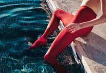 Red tights in not so deep blue waters.