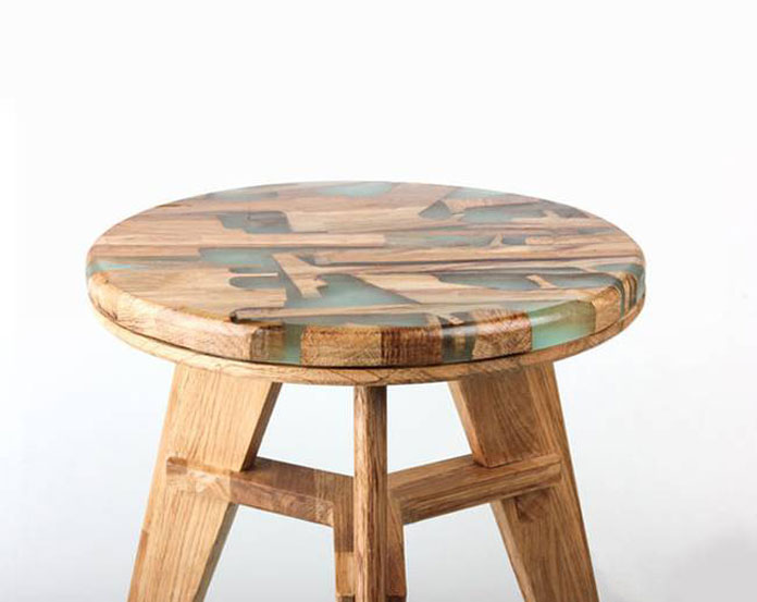 Close up of the wood stool by Hattern.