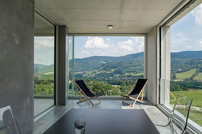 The house provides great views of the hilly landscape.