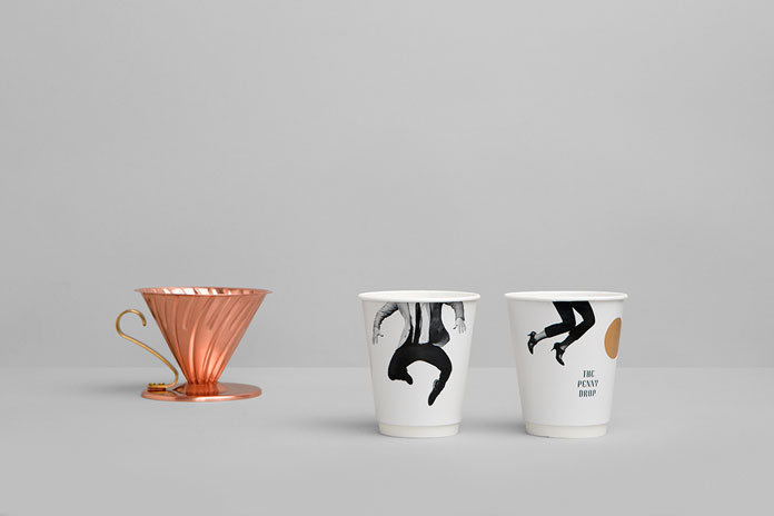 Printed coffee mugs.