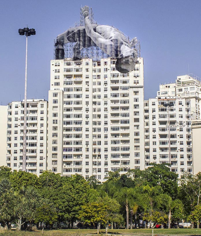 Giant athlete installation in Rio de Janeiro by French artist JR.