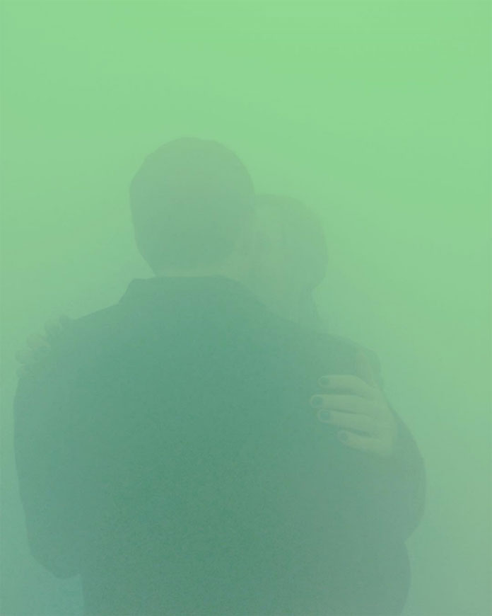 Couple captured in mint green colors at the Ann Veronica Janssens yellowbluepink installation.