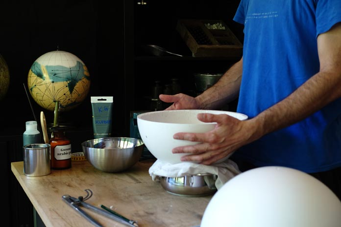 Michael Plichta uses traditional globemaking techniques.