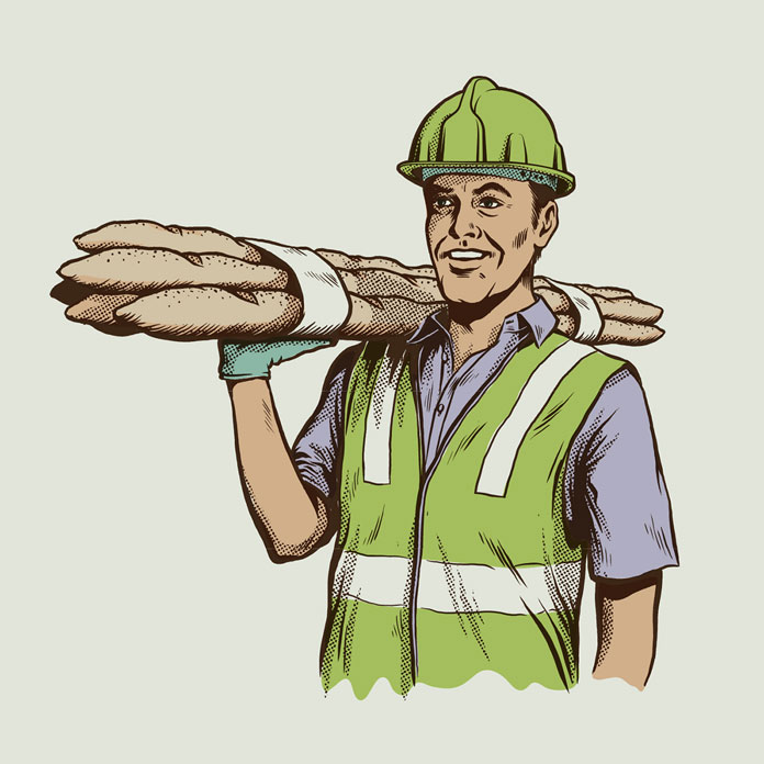 A construction worker is carrying delicious baguettes.
