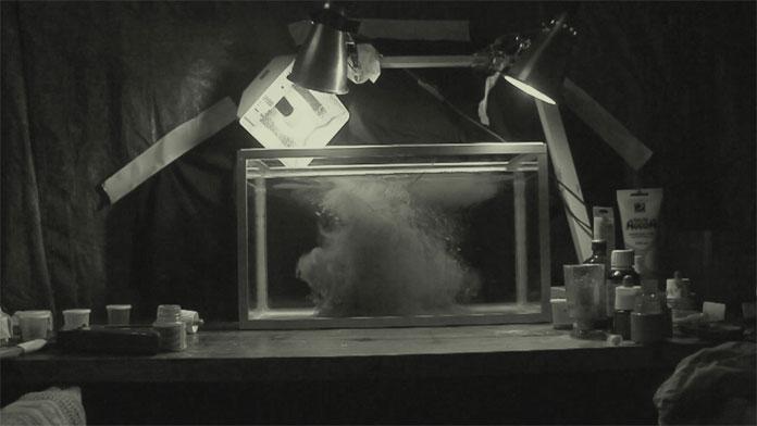 Thomas Vanz used an aquarium, ink and water.