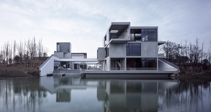 View from the water towards the Intangible Cultural Heritage Museum in China by Vector Architects.