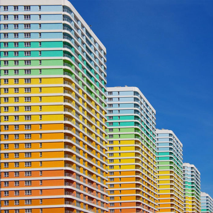 Rainbow colored buildings side by side.