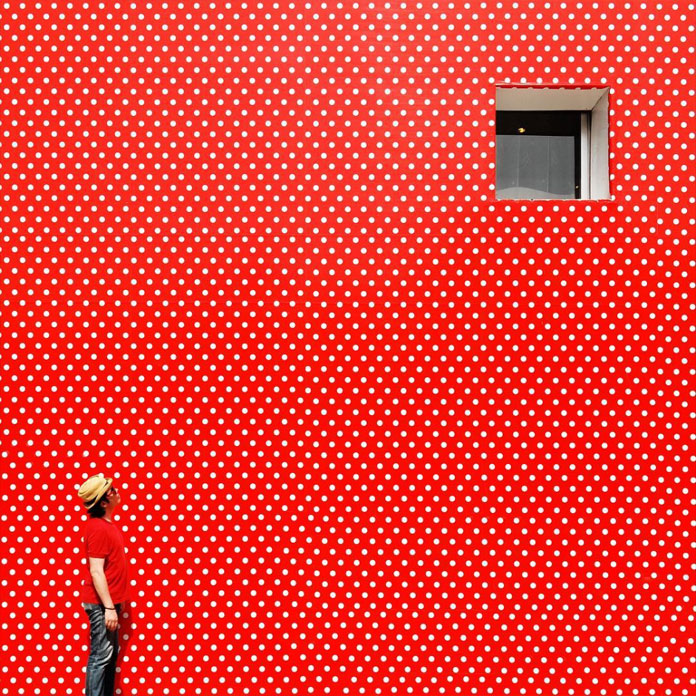 Red wall with white dots.