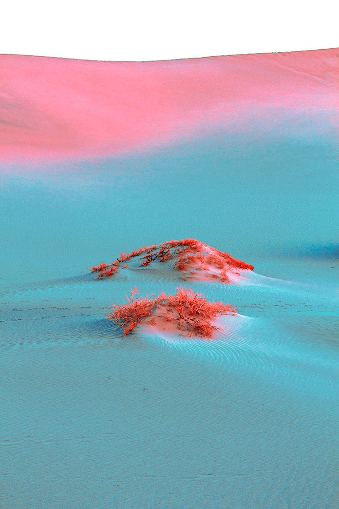 Sand dunes in light blue and pink.