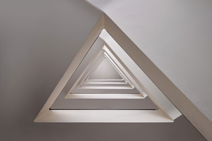 The triangle construction creates a geometric look.