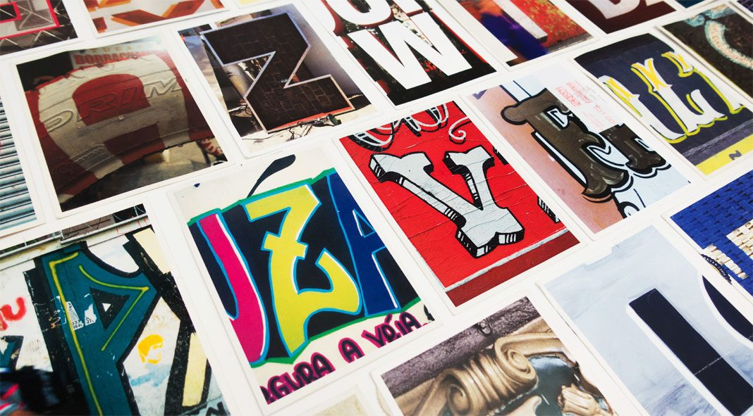 Typographic postcards that compare New York City and São Paulo.