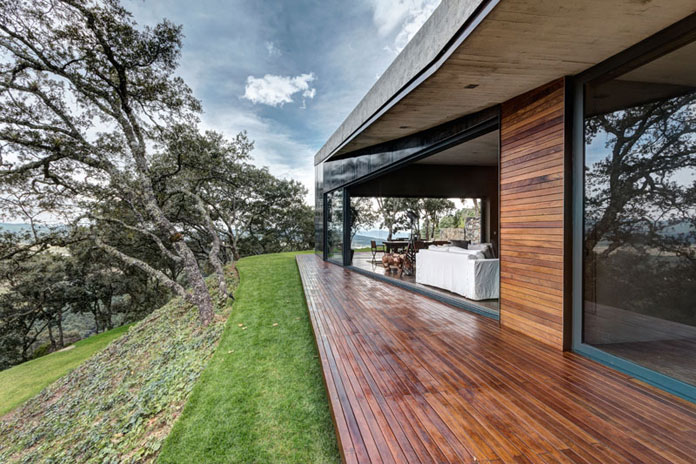 Covered wood exterior space, GG House by Elías Rizo Arquitectos.