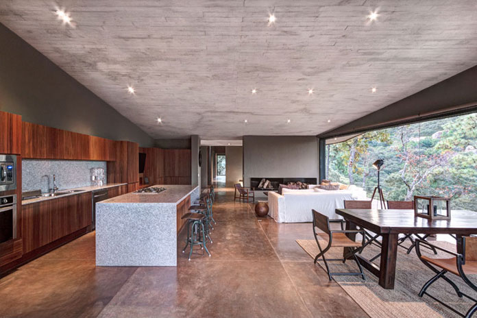 Open plan interior space - living room and kitchen, GG House by Elías Rizo Arquitectos.