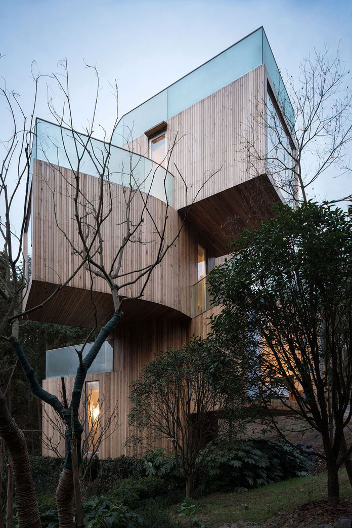 Qiyunshan Tree House by Bengo Studio, Volumes stacked around a tree.