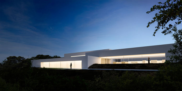 Casa Zarid by Fran Silvestre Arquitectos, View of the house after sunset.