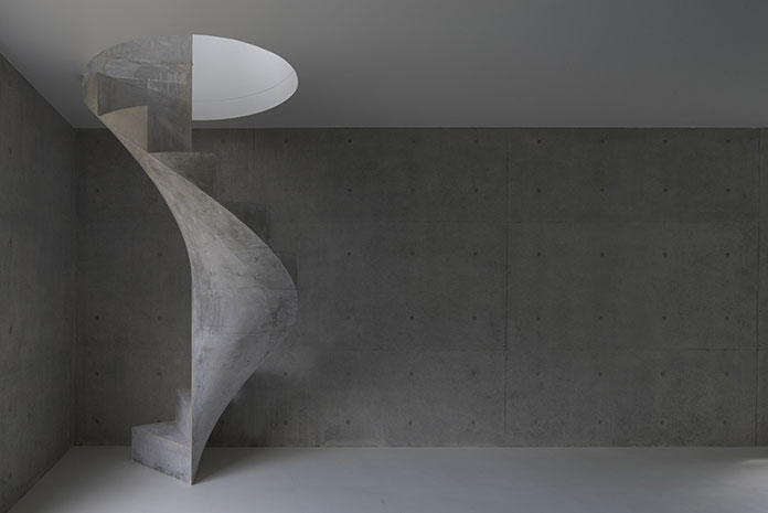 Concrete spiral staircase acts like a permanently installed sculpture.
