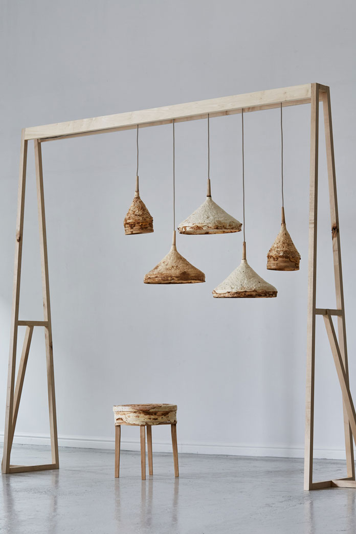 A stool and a series of hanging lamps.