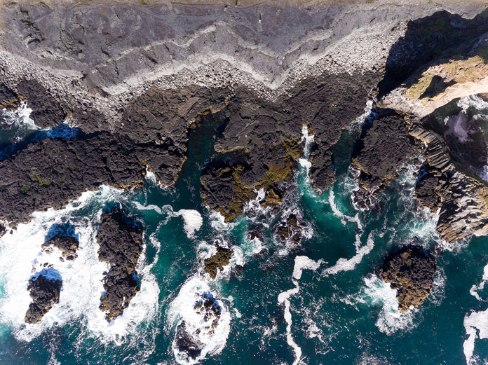 Iceland from above - aerial photography by Kevin Krautgartner, cliffs in the ocean.