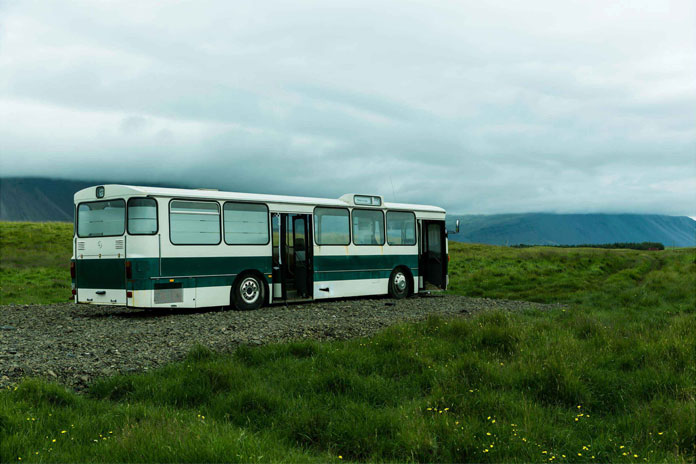 A bus in an abandoned landscape.