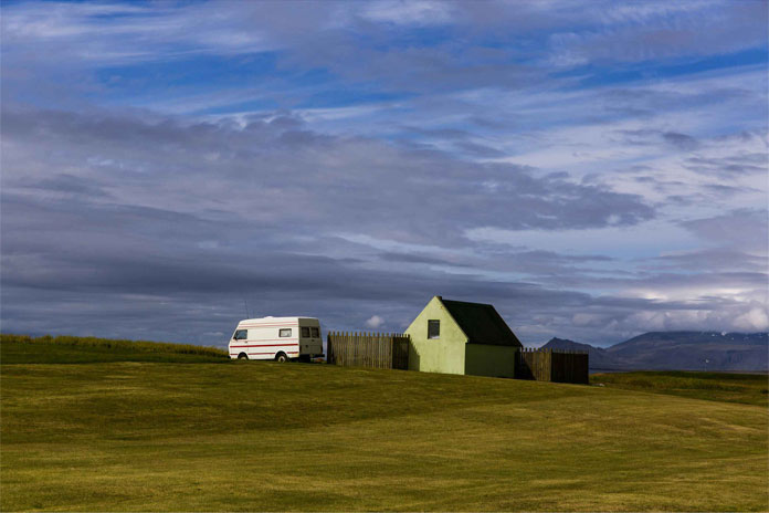 A camper van and a lonely house.