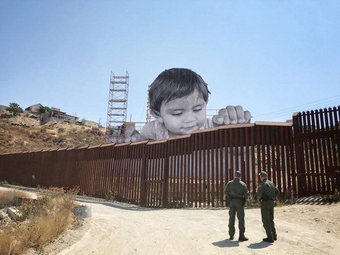 Installation by French artist JR placed on the border between the USA and Mexico.