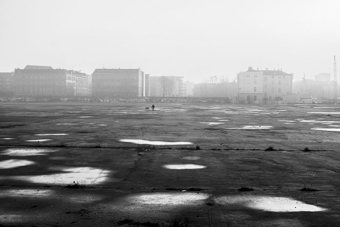 On His Own – photo series by Pawel Franik, in front of the old town