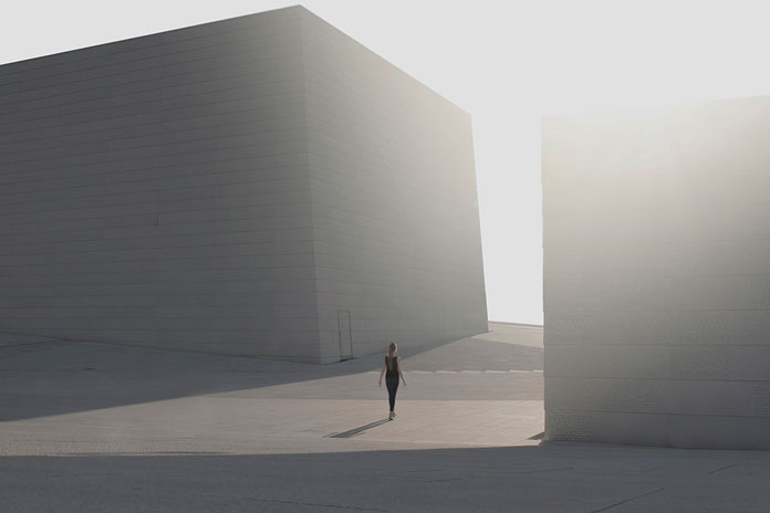 On His Own – photo series by Pawel Franik, a loner surrounded by minimalist architecture