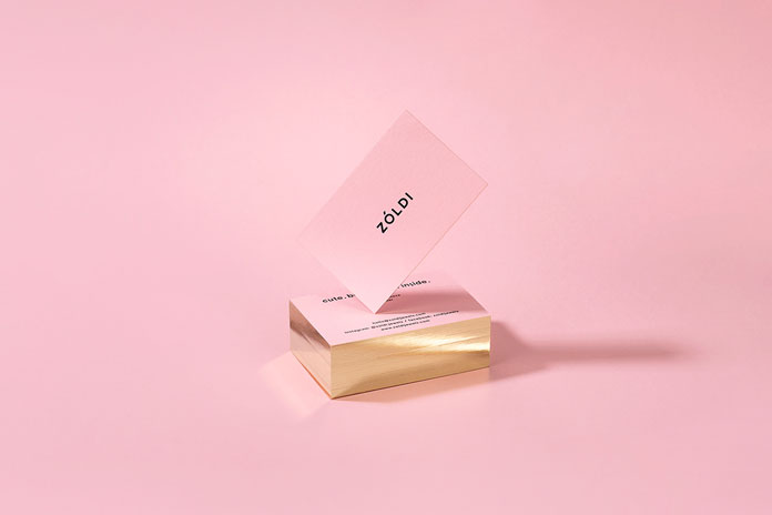 Pink business cards with golden edges.