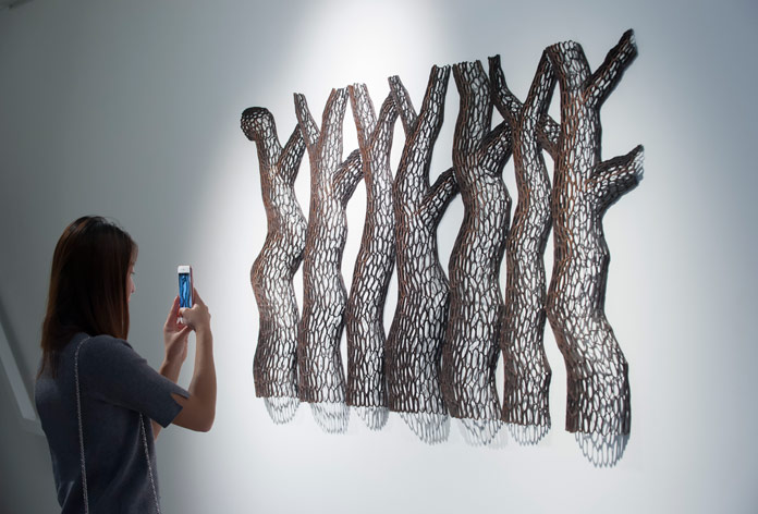 Sculptures created through spiraling branches, curves, and notches.