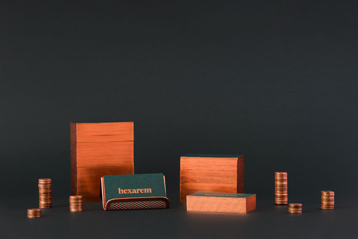 Business cards with copper-colored edges.