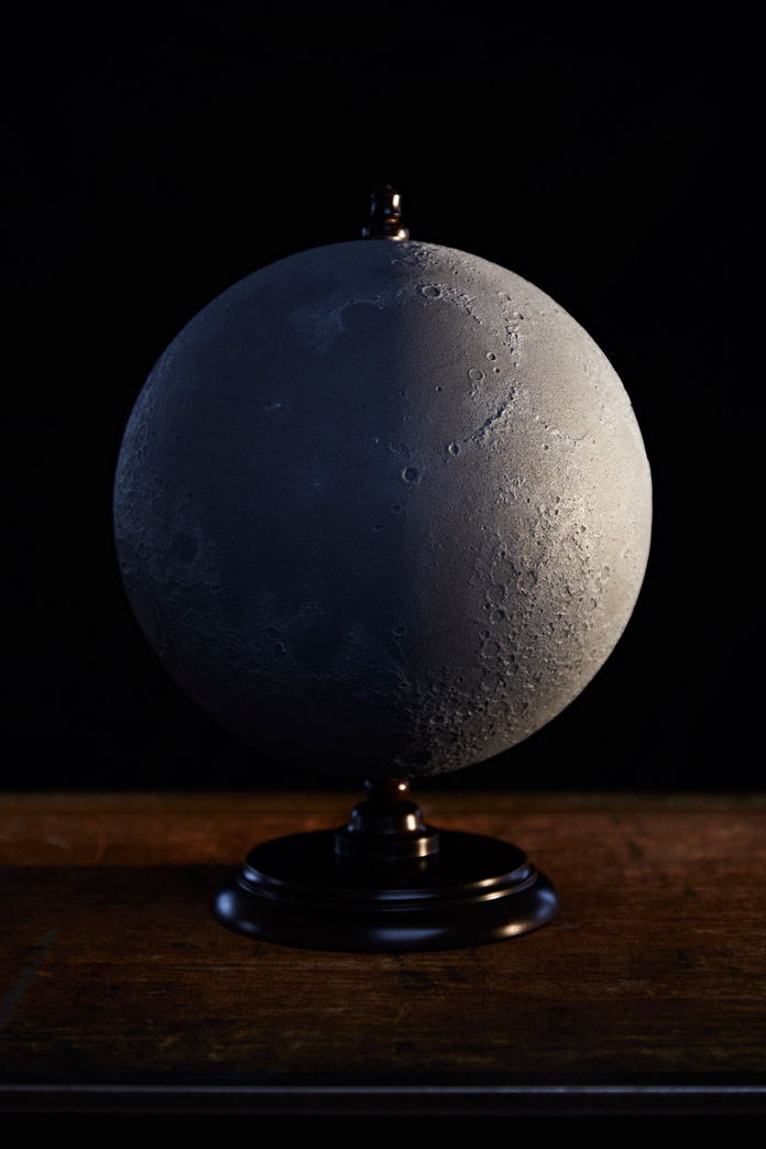 A hyper realistic moon globe made by Michael Plichta of Planetenkugel-Manufaktur.