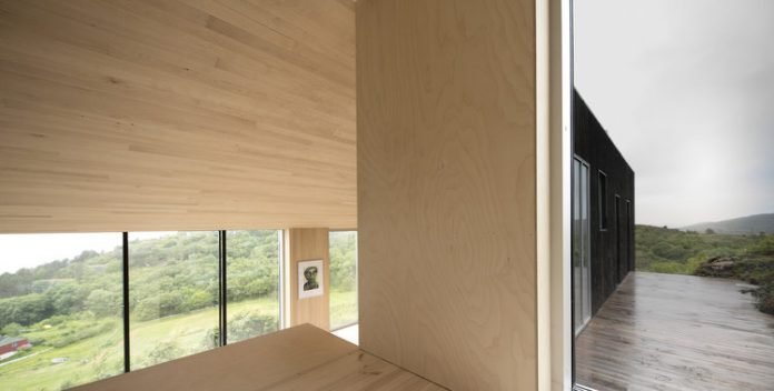 A wood cabin designed by Kappland Arkitekter on the Norwegian island Stokkøya.