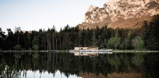 Lake House Völs, a discreet and small lake-hut in the heart of the magnificent mountain landscape of the Sciliar in the South Tyrolean Dolomites in Italy.
