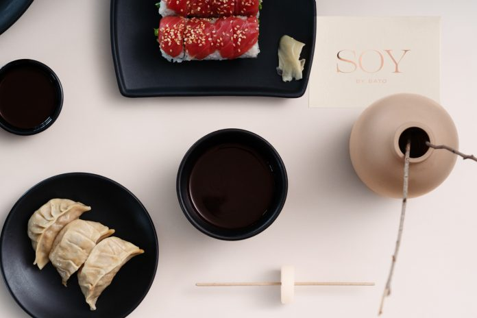 Graphic design and branding by studio Futura for Soy by Sato, a high-end Asian bao restaurant located in Doha Qatar.