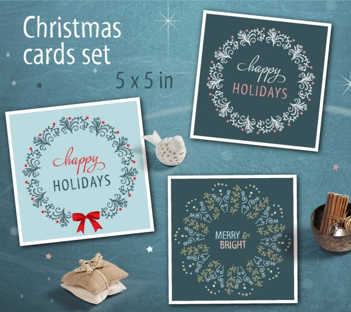 The square Christmas cards with intricate wreath illustrations are available here.