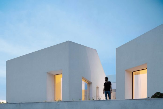 Three old houses converted into one by Paulo Merlini Architects.
